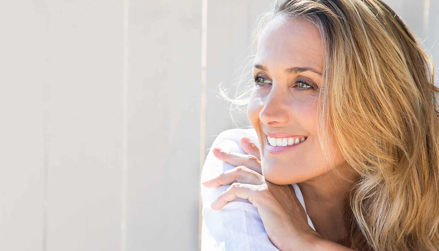 A gorgeous middle-aged woman smiles